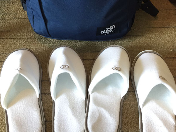 White slippers inside Sofitel's room